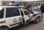 苏州一彪悍女司机驾车撞击警车 三拳击碎挡风玻璃
