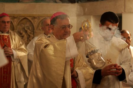 Latin Patriarch Fuad Twal heads a mass at the Latin Church in the West Bank city of Beit Sahour near Bethlehem on December 19, 2009.