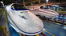 Two high-speed trains stop at the high-speed railway maintenance base in Wuhan, capital of central China's Hubei Province, December 22, 2009.