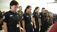 Members of Chinese peacekeeping anti-riot police team mourn in a ceremony commemorating the UN personnel that perished in Haiti's Jan. 12 earthquake in Port-au-Prince, capital of Haiti, March 9, 2010.