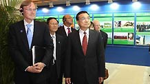 Chinese Vice Premier Li Keqiang (R, front) and World Bank President Robert Zoellick (L, front) visit an exhibition before the opening ceremony of the Conference ot the 30th Anniversary of China-World Bank Cooperation in Beijing, Sept. 13, 2010.