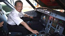 Chinese Primer Wen Jiabao inspects the layout of the pilot's compartment in an A320 plane under assembly in Tianjin on the sidelines of the 2010 Summer Davos Forum, Sept 12.