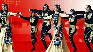 Artists from Georgia perform during a ceremony marking the National Pavilion Day for Georgia at the 2010 Shanghai World Expo, in Shanghai, east China, Oct. 28, 2010.