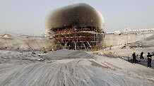 Workers take off the acrylic rods of the UK Pavilion in the World Expo Park in Shanghai, east China, Dec. 8, 2010. The