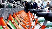 Public bicycles are seen at a rent point in Haikou, capital of south China's Hainan Province, Jan. 11, 2011.