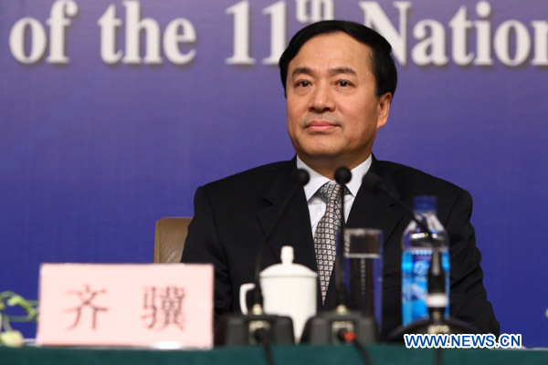 Qi Ji, vice minister of House and Urban-Rural Construction, attends a news conference of the Fourth Session of the 11th National People's Congress (NPC) focusing on indemnificatory housing construction and regulation of the real estate market in Beijing, capital of China, March 9, 2011.