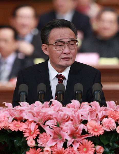 Wu Bangguo, chairman of the Standing Committee of the National People's Congress (NPC), delivers a work report of the Standing Committee of the NPC during the second plenary meeting of the Fourth Session of the 11th NPC at the Great Hall of the People in Beijing, capital of China, March 10, 2011.