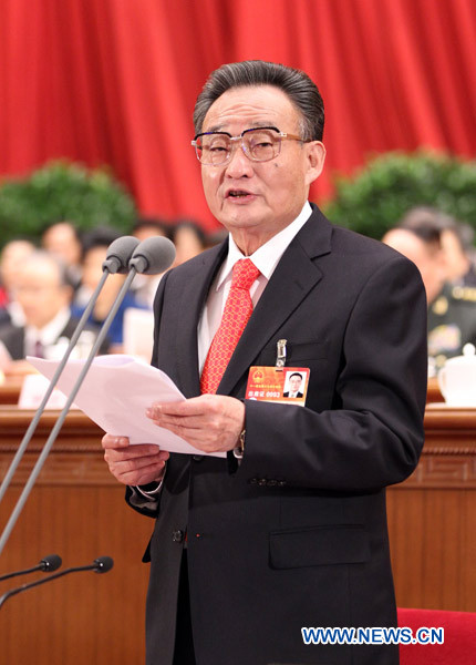 Wu Bangguo, chairman of the Standing Committee of the National People's Congress (NPC), presides over the closing meeting of the Fourth Session of the 11th NPC at the Great Hall of the People in Beijing, China, March 14, 2011.