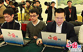 China.com.cn journalists prepare for the closing press conference of the Fourth Session of the 11th National People's Congress at the Great Hall of the People in Beijing on Monday, March 14, 2011. Premiere Wen Jiabao spoke at the press conference.