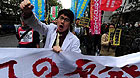 A protester shouts slogans during an anti-nuclear march in Tokyo, Japan, March 31, 2011.