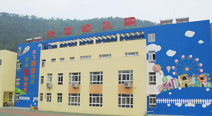 New buildings are seen in Muyu Middle School in Qingchuan County, southwest China's Sichuan Province, in 2011.