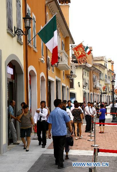 People shop at Tianjin Florence Town Outlets in Wuqing District of north China's Tianjin Municipality, June 9, 2011.