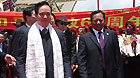 Li Jianguo (front right), deputy chief of a central government delegation sent to attend the celebrations marking the 60th anniversary of Tibet's peaceful liberation, is greeted by Benpa Drasi, secretary of the Communist Party of China committee of Nagqu Prefecture on July 21, 2011.