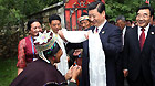 Chinese Vice President Xi Jinping (C, Front) receives a traditional white scarf known as 'hada' during a visit to the village of Bagyi in Nyingchi Prefecture, southwest China's Tibet Autonomous Region, July 21, 2011.