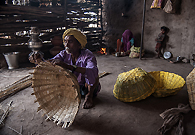 Mangu Keriya is a basket weaver who received financial assistance from local NGOs to improve his business.