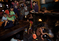 Seven families of a leather factory workers cram into a single room at a slum in Kolkata where each family has a chowki (wooden cot) to live on. A recent report says 33 percent of the city's population lives in the slum with an approximate number of 1,600,000 and most of them are staying far below poverty level.