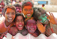 Children from poverty-hit areas are celebrating Holi – the festival of colors in happy mood.