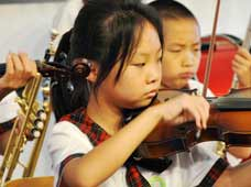 The orchestra of the Duan Village Primary School puts on a performance on Sept.13, the first day of the school term.