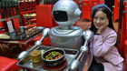 Intelligent service robot serve clients in snacks bar in Chengdu, capital of southwest China's Sichuan Province, Dec. 14, 2014.