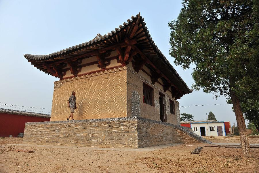 The Guangrenwang Temple is seen being repaired in this photo taken on August 5, 2014. [File Photo: Xinhua]