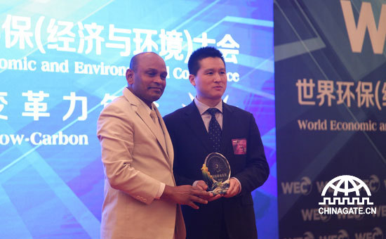 """Micoe Group, a firm which produces solar water heater, water purifier and so on, wins International Carbon-Value Award during the 7th """"WEC 2014 Annual Meeting on Green and Low Carbon Transformational Development - International Carbon-Value Award Ceremony"""". [Chinagate.cn]"""