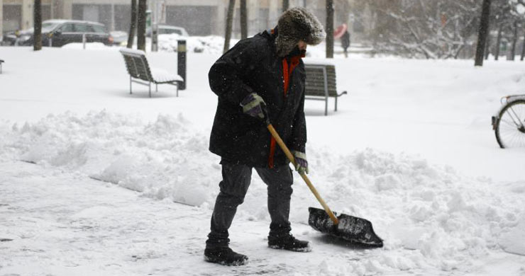 A worker cleans a road as heavy snow hit the capital city Bratislava, Slovakia, Feb. 9, 2015