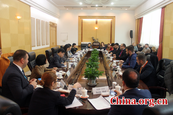 The youth leaders delegation of Central and Eastern European Countries visited the International Department of the CPC Central Committee in Beijing on Nov. 28. [Photo by Mi Xingang/China.org.cn]