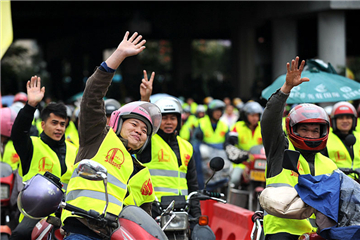 Migrant workers ride motorcycles home