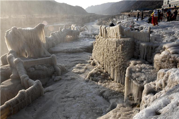 Frozen Hukou Waterfall on Yellow River