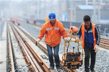 Workers adjust Wuhan-Jiujiang Passenger Railway