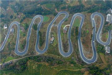 Road looks like jade belt around mountain