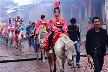 Children dressed as legendary figures parade on horseback
