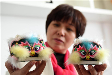 Chinese folk handicraft: tiger-head shoes