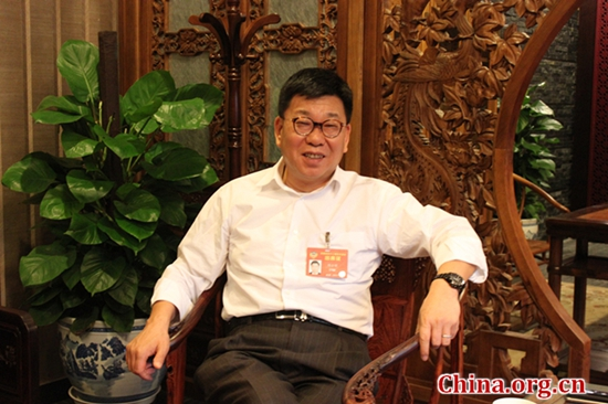 Han Fangming, the founding chairman of the Charhar Institute and vice chairman of the Foreign Affairs Committee of the National Committee of CPPCC, speaks to a China.org.cn reporter in Beijing, March 11, 2017. [Photo/ China.org.cn]