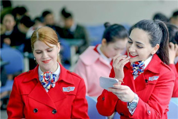 Foreign teachers apply to be flight attendants