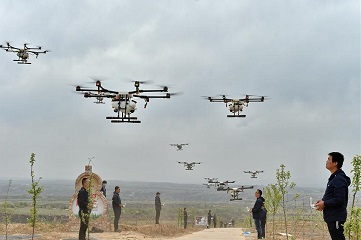 People fly drones to spray pesticide in north China