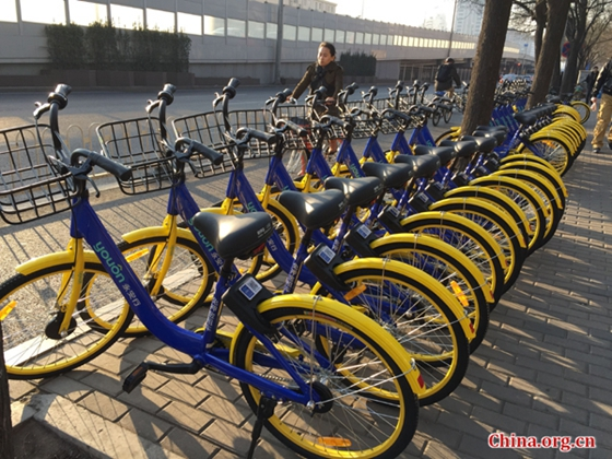 Shared bikes are seen on a street in the Haidian District, Beijing, on February 27, 2017. [Photo by Li Jingrong/China.org.cn